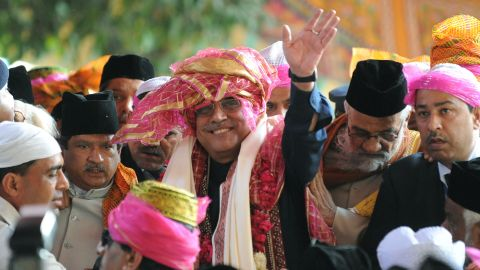 File photo of President Asif Ali Zardari, center, on  April 8, 2012 during a visit to India.