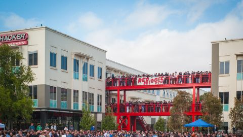 A crowd gathers in an outdoor plaza, dubbed Hackers Square, to hear Facebook's CEO kick off the Hackathon.