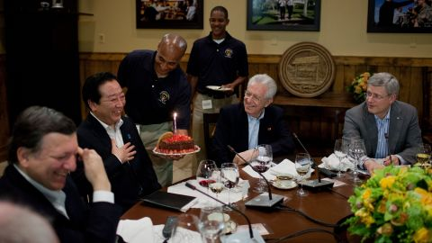 Delegates celebrate the Japanese prime minister's birthday during a G8 working dinner in Laurel Cabin at Camp David. Noda turns 55 on Sunday.