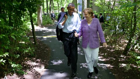 Obama and Merkel talk as they walk to Aspen Cabin.