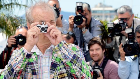 """Bill Murray poses with a miniature camera at the photocall for """"Moonrise Kingdom"""" on Wednesday, May 16. The latest film from director Wes Anderson served as this year's curtain raiser."""