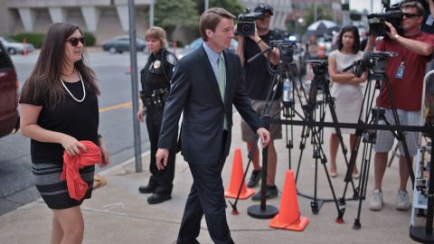 John Edwards returns with his daughter, Cate, to the courthouse in Greensboro on Monday after a lunch break.