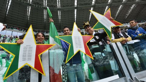 """Juventus fans hold up three stars to signify the 30 championships won by the club, but two in 2005 and 2006 have been struck off the official records after the """"Calciopoli"""" match-fixing scandal."""