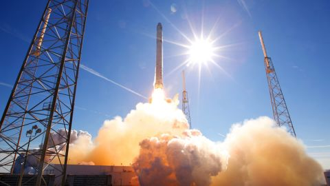 SpaceX's Falcon 9, carrying a Dragon space capsule, launches from Cape Canaveral in December 2010.