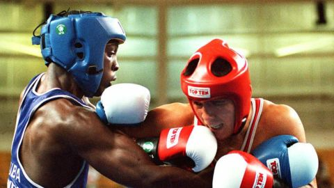 Hector Vinent Charon trains the youngsters at the Rafael Trejo boxing gym in Havana. Charon (left) is a two-time Olympic gold medalist, having won the light welterweight at both the 1992 and 1996 Games.