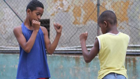 Boys at a Havana gym practice their boxing stance. Boxing, like baseball, is a sport many Cubans are passionate about.