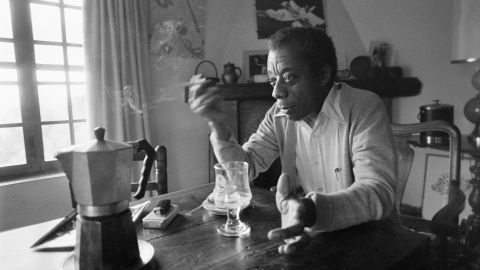 American novelist, poet, and gay and civil rights activist James Baldwin poses at his home in 1979.