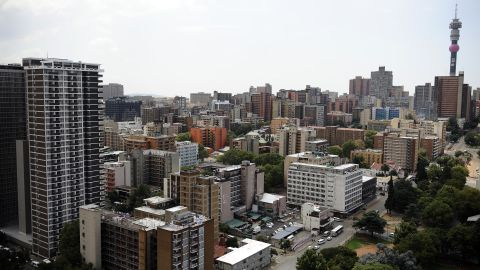 An aerial view of downtown Johannesburg, with the 269m Hillbrow Tower, Africa's tallest structure, in the background. The city center has been the site of intensive rejuvenation efforts following years of urban decay in the 1990s.