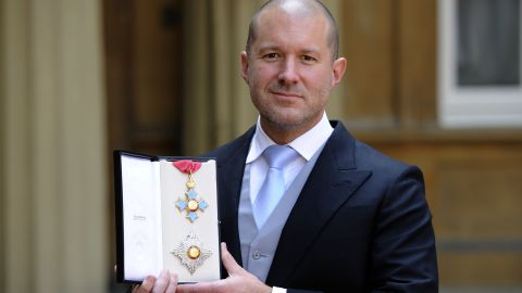 Jonathan Ive holds his Knight Commander medal following a ceremony at Buckingham Palace, on May 23, 2012 in London.