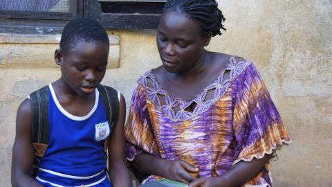 Deborah, a participant in Worldreader's pilot program in Ghana, reads with her mother. Students are encouraged to take home their e-readers to share the benefits of the device with their families.
