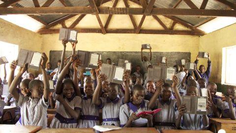 Students show off their e-readers at Menara Primary School, Mnara, Kenya. Worldreader is currently operating in Kenya, Ghana and Uganda, and will soon start projects in Rwanda.