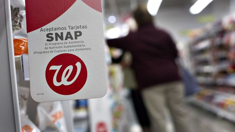A notice of acceptance of Supplemental Nutritional Assistance Program (SNAP) cards hangs at a Walgreens in Chicago.