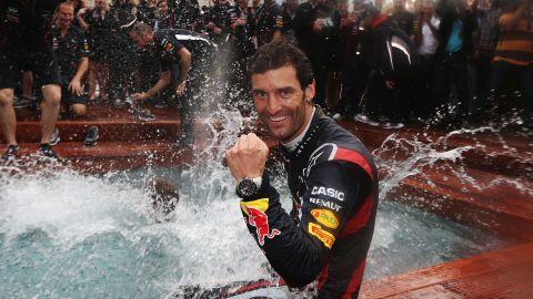 Webber takes a post-race dip as the Red Bull team celebrate a third consecutive Monaco triumph.