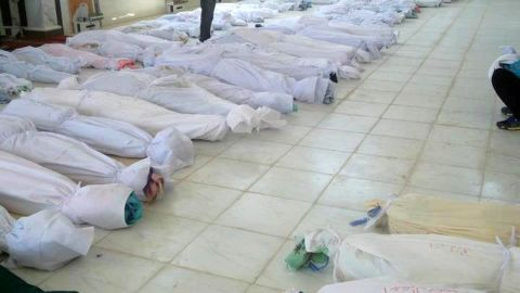 Bodies lie in a hospital morgue before their burial in the central Syrian town of Houla on Saturday.