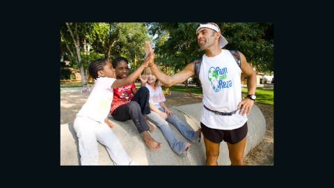 Baluchi says he runs to help children around the world realize anything is possible.