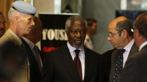 U.N. envoy Kofi Annan, center, meets with Maj. Gen. Robert Mood, U.N .mission chief in Syria, left, in Damascus on Monday.