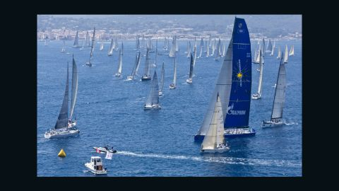The yacht's distinctive blue and yellow branding echoes the colors typically associated with the European Union.