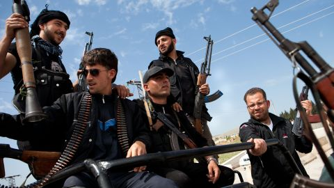 Syrian fighters from a group calling themselves 'The right bombs squad', many of who left their studies and jobs to join rebels, hold their weapons at a checkpoint controlled by the Free Syrian Army (FSA) at Epin, in the north-western province of Idlib, on April 15, 2012.