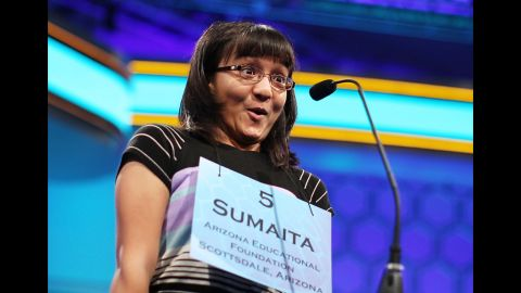 Sumaita Mulk of Goodyear, Arizona, celebrates on Thursday, May 31, at the Scripps National Spelling Bee after she correctly spelled her word during the fourth round. Fifty spellers advanced to compete in the semifinals on the last day of the competition.