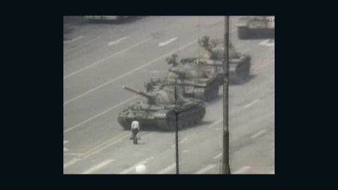 """In this iconic image, an anonymous """"tank man"""" stands in protest in front of a column of Chinese tanks on June 5."""