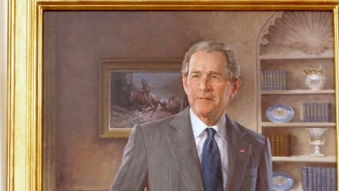 """The portrait of Bush shows a 1929 Western painting, """"A Charge to Keep,"""" over the president's right shoulder. According to the White House, Bush often called attention to that painting and its significance."""