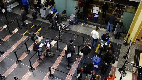 Travelers go through a TSA checkpoint at Reagan National Airport in Washington.
