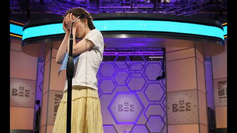 """Speller Lena Greenberg of Philadelphia covers her face during round 9 of the competition after she misspelled the word """"geistlich.""""  Greenberg was eliminated from the competition."""