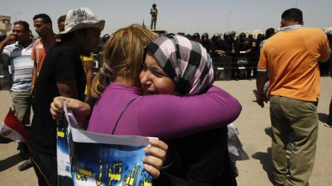 Emotional anti-Mubarak protesters embrace after the verdict against the former president was handed down.