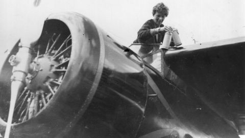 American aviator Amelia Earhart (1898 - 1937) in the cockpit of her aeroplane at Culmore, near Derry, Ireland, after her solo Atlantic flight.