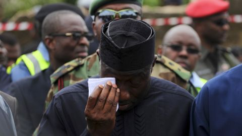 President Goodluck Jonathan wipes a tear during a visit to the site of the crash in Lagos on Monday.