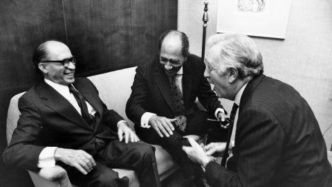 Israeli Prime Minister Menachem Begin and Egyptian President Anwar al-Sadat laugh with Cronkite at the King David Hotel in Jerusalem in November 1977.
