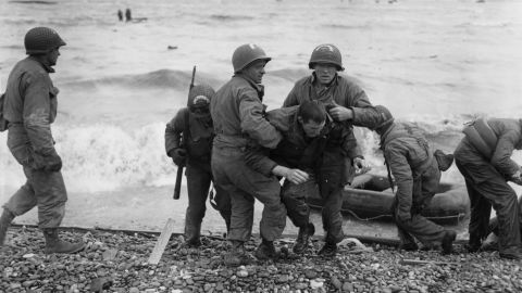 American troops help their injured comrades after their landing craft was fired upon. Although the true number of casualties on D-Day will never be known, it is estimated that approximately 10,000 Allied soldiers were killed, wounded and or were missing in action.
