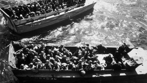 US troops wait to disembark a landing craft on D-Day. The Allies went to elaborate lengths to maintain secrecy and mislead Adolf Hitler. They employed double agents and used decoy tanks and phony bases in England to hide actual troop movements.