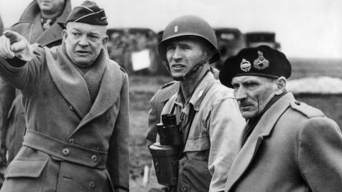 U.S. Gen. Dwight D. Eisenhower, left, supreme commander of the Allied forces, and British Field Marshal Bernard Montgomery, right, discuss plans at an undisclosed location in June 1944. The Allies went to elaborate lengths to maintain secrecy and mislead Adolf Hitler. They employed double agents and used decoy tanks and phony bases in England to hide actual troop movements.