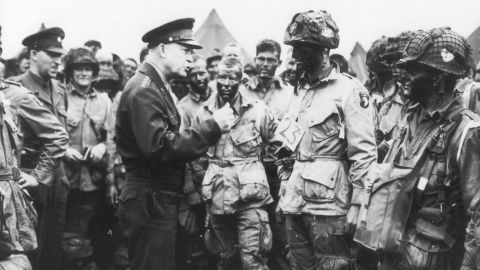 """Eisenhower gives the order of the day to paratroopers in England. """"Full victory -- nothing else"""" was the command just before they boarded their planes to participate in the first wave. The invasion -- code-named Operation Overlord -- had been brewing for more than two years."""