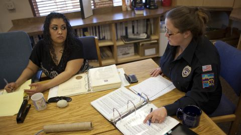 Columbus Mayor Nicole Lawson, right, goes over minutes with municipal clerk Natalia Baeza. Lawson, who became mayor last year, is trying to help the village overcome a huge budget shortfall after last year's federal raid.