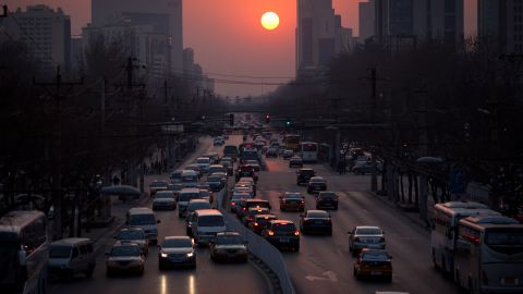 The sun sets over traffic in Beijing on March 25, 2012.
