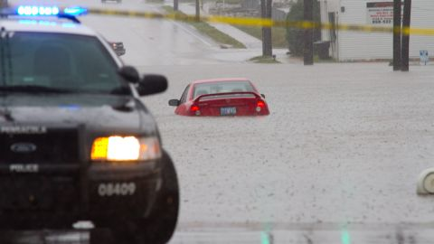 """Cars struggled with flooded roads Saturday in Pensacola. """"These are areas I have never seen flood like this, and we have endured some pretty big hurricanes through here before,"""" iReporter Randy Hamilton says."""