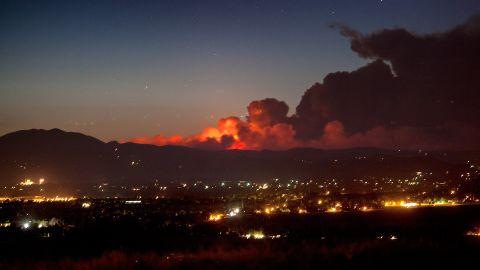 The sprawling wildfire lights up the night sky Saturday in a photo from CNN iReporter Randy S. Macht taken in Louisville, Colorado, south of the blaze.