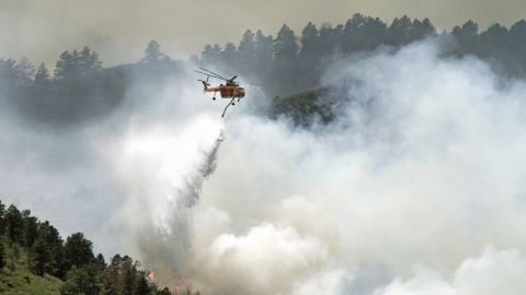 iReporter Victor W. Schendel, a Fort Collins photographer, has been watching the fast-moving wildfire grow and took this photo Tuesday as firefighters attempted to control the blaze.