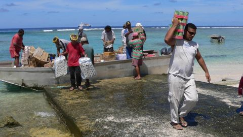Residents unload goods from a barge in Nukunonu atoll, Tokelau, which has no airport or port.