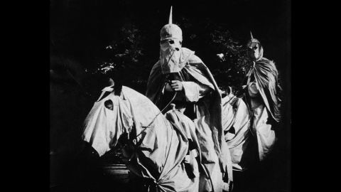 """Actors in the silent film """"The Birth of a Nation,"""" released in 1915, portrayed Ku Klux Klan members dressed in full regalia and riding horses."""