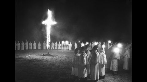 A cross burns in a field during a Ku Klux Klan rally in 1946.