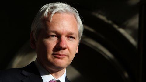 WikiLeaks founder Julian Assange speaks to the media outside the High Court in London on December 5, 2011.