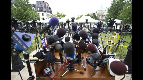 The podium stand outside of Jerry Sandusky's trial on its first day is covered in mics, hinting at the massive media coverage of the event.