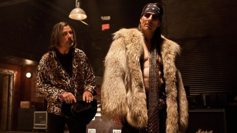 """Alec Baldwin, left, stars as Dennis Dupree and Tom Cruise stars as Stacee Jaxx in Adam Shankman's """"Rock of Ages."""""""