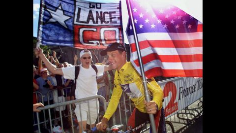 Armstrong takes his honor lap on the Champs-Élysées in Paris after winning the Tour de France for the first time in 1999.
