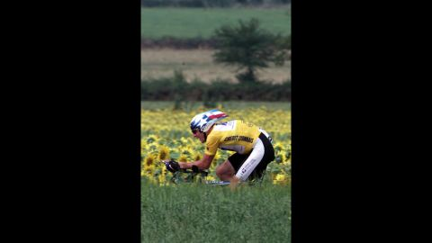 Armstrong rides during the 18th stage of the 2001 Tour de France. He won the tour that year for the third consecutive time.