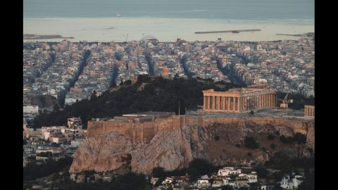 The Parthenon temple is seen on the skyline of Athens.