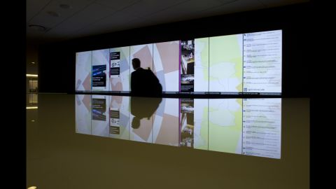 A large video screen in the WorkCafe updates with tweets, news and other information.
